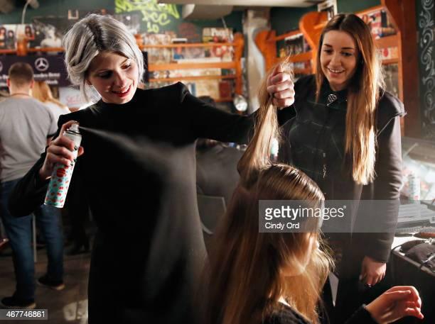 Lead hair stylist Stephanie Hayes uses Batiste Dry Shampoo backstage at the Charlotte Ronson Fall 2014 Presentation during MercedesBenz Fashion Week...