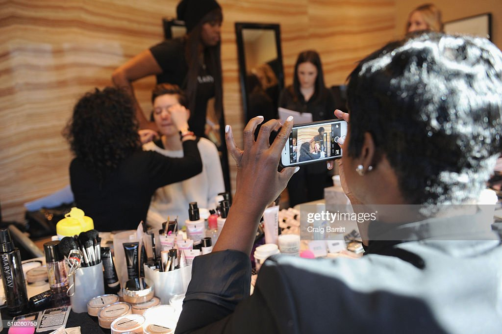 Lead makeup artist Deanna Melluso helps preparing a model backstage during Mary Kay at Tracy Reese F/W '16- Presentation during New York Fashion Week at Roxy Hotel on February 14, 2016 in New York City.