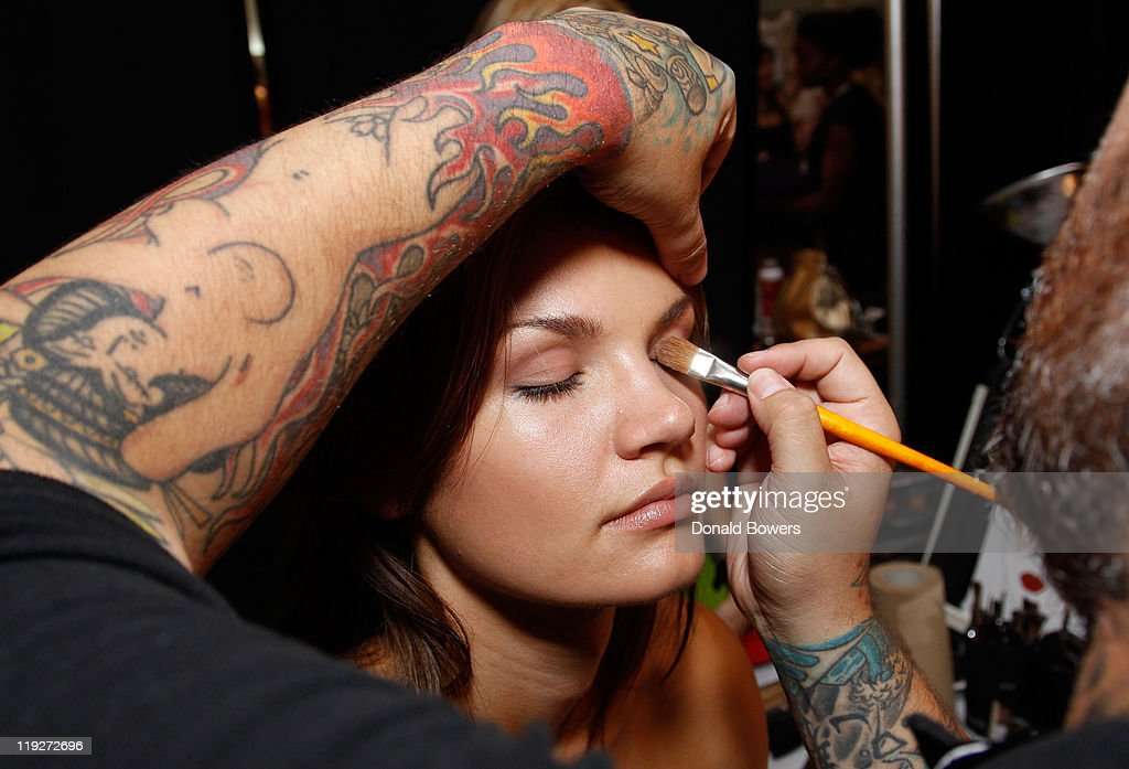 Lead Make-up Artist James Vincent styles a model backstage at the Beach Bunny Swimwear show during Mercedes-Benz Fashion Week Swim 2012 at The Raleigh on July 15, 2011 in Miami Beach, Florida.
