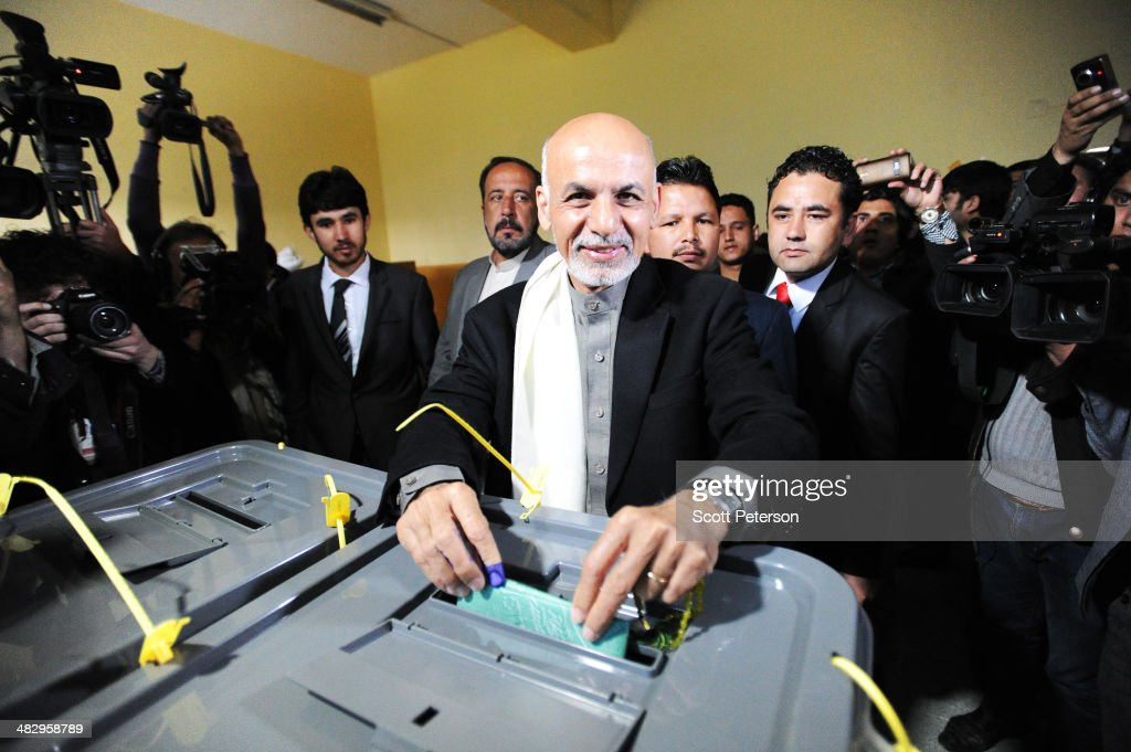 Lead presidential candidate <a gi-track='captionPersonalityLinkClicked' href=/galleries/search?phrase=Ashraf+Ghani&family=editorial&specificpeople=2085543 ng-click='$event.stopPropagation()'>Ashraf Ghani</a> Ahmadzai casts his ballot as Afghans defy Taliban threats and vote in record numbers in elections on April 5, 2014, in Kabul, Afghanistan. On a day that was largely peaceful in the capital and urban centers, despite Taliban vows to disrupt the vote and kill those who took part, Afghans clogged polling stations in Kabul and urban centers, reaching an estimated 60 percent turnout to elect a successor to President Hamid Karzai.