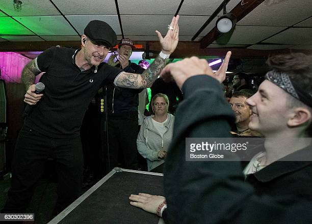 Lead singer Al Barr of the Dropkick Murphys highfives the crowd during their performance at the Beachcomber in Quincy MA on its last night in...