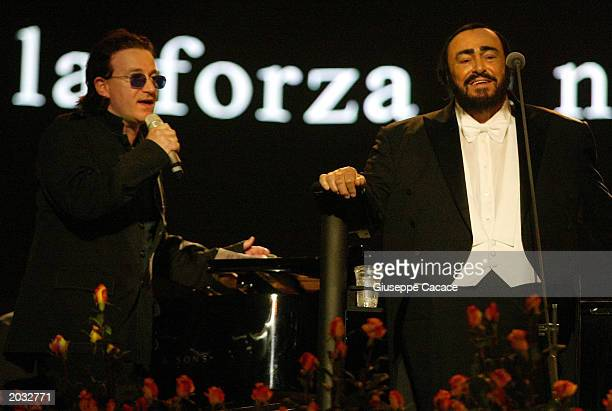U2 lead singer Bono and Luciano Pavarotti perform at the Pavarotti and Friends 2003 concert May 27 2003 in Modena Italy This year's concert the 10th...