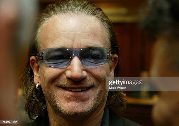 U2 lead singer Bono smiles before testifying to a Senate Appropriations Subcommittee on Foreign relations Capitol Hill May 18 2004 in Washington DC...