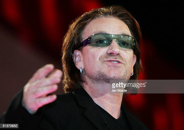 U2 lead singer Bono speaks during the fourth day of the Labour Party Annual Conference on September 29 2004 in Brighton England The singer the star...