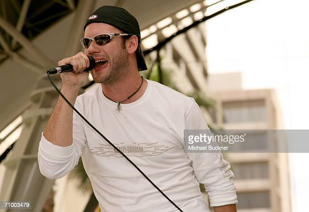 Lead singer Brad Mates of Emerson Drive performs at the Academy of Country Music celebrity motorcycle ride in and concert held at 3rd Street Stage...