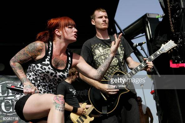 Lead singer Candace Kucsulain and Guitar player Chris Rawson of Walls of Jericho perform during the Rockstar Energy Mayhem Festival at the Verizon...