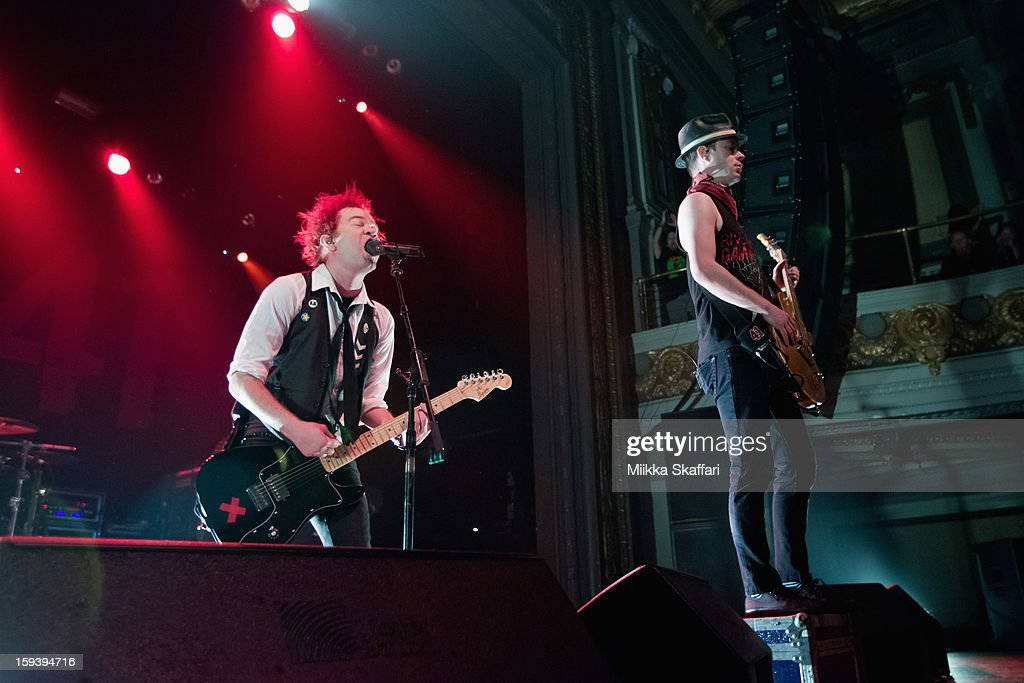 Lead singer <a gi-track='captionPersonalityLinkClicked' href=/galleries/search?phrase=Deryck+Whibley&family=editorial&specificpeople=213117 ng-click='$event.stopPropagation()'>Deryck Whibley</a> and guitarist Tom Thacker of Sum 41 performs on stage at Grand Regency Ballroom on January 12, 2013 in San Francisco, California.