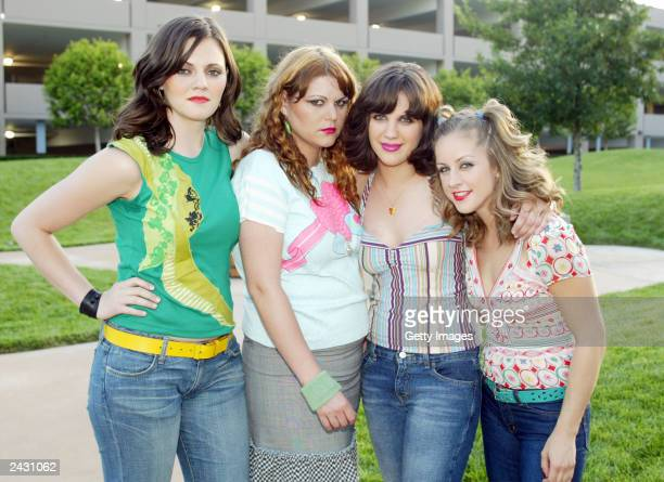 Lead singer for The Donnas Brett Anderson bass player Maya Ford lead guitar Allison Robertson and drummer Torrance Castellano pose inbetween shooting...