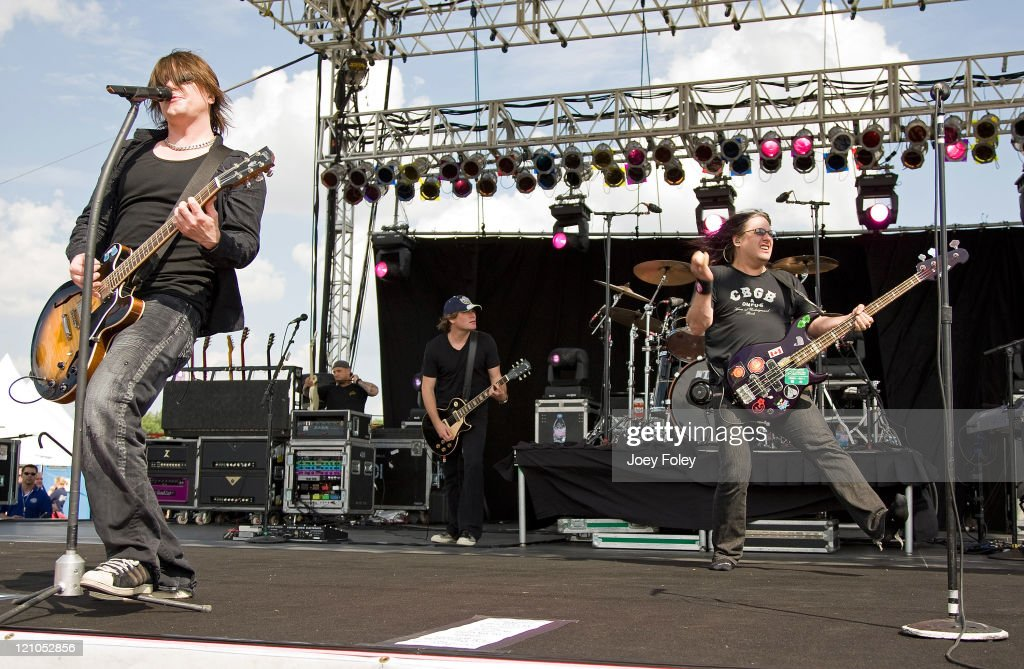Lead singer John Rzeznik bassist Robby Takac and drummer Mike Malinin of The Goo Goo Dolls perform live in concert during Qualifying day for the 15th...