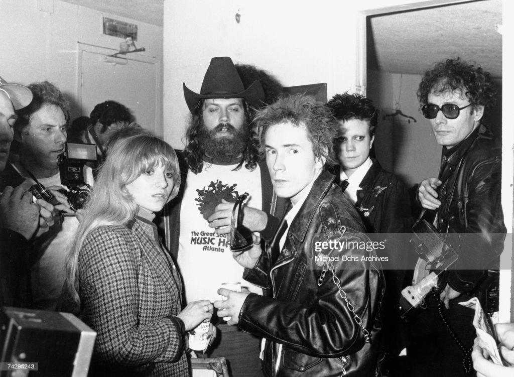 Lead singer Johnny Rotten (wearing a leather jacket in front) of the punk band 'The Sex Pistols' greets fans backstage after their last concert in Winterland on January 14, 1978 in San Francisco, California.