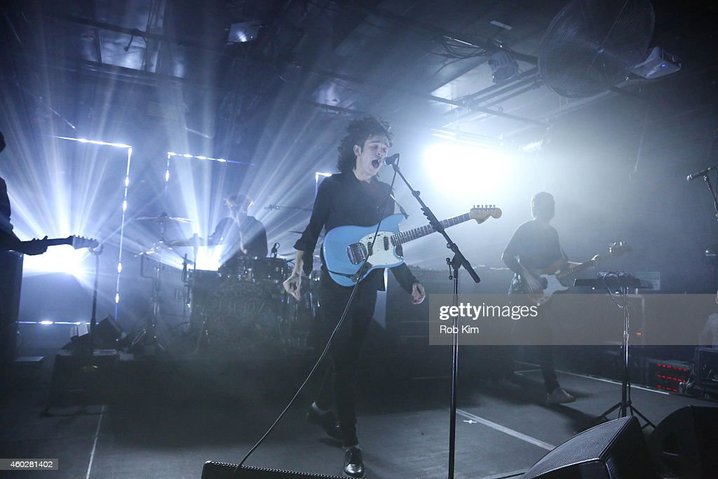 Lead singer Matt Healy (C) and band <a gi-track='captionPersonalityLinkClicked' href=/galleries/search?phrase=The+1975+-+Band&family=editorial&specificpeople=9164092 ng-click='$event.stopPropagation()'>The 1975</a> perform at Tumblr's Year In Review 2014 at Brooklyn Night Bazaar on December 10, 2014 in New York City.