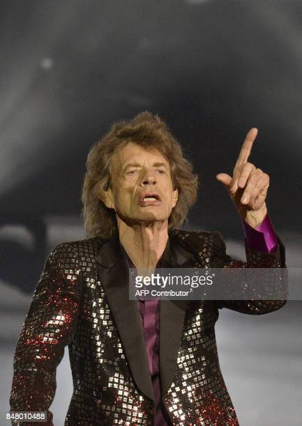 Lead singer Mick Jagger of 'The Rolling Stones' gestures during a concert on September 16 in Spielberg / AFP PHOTO / APA / HERBERT PFARRHOFER /...