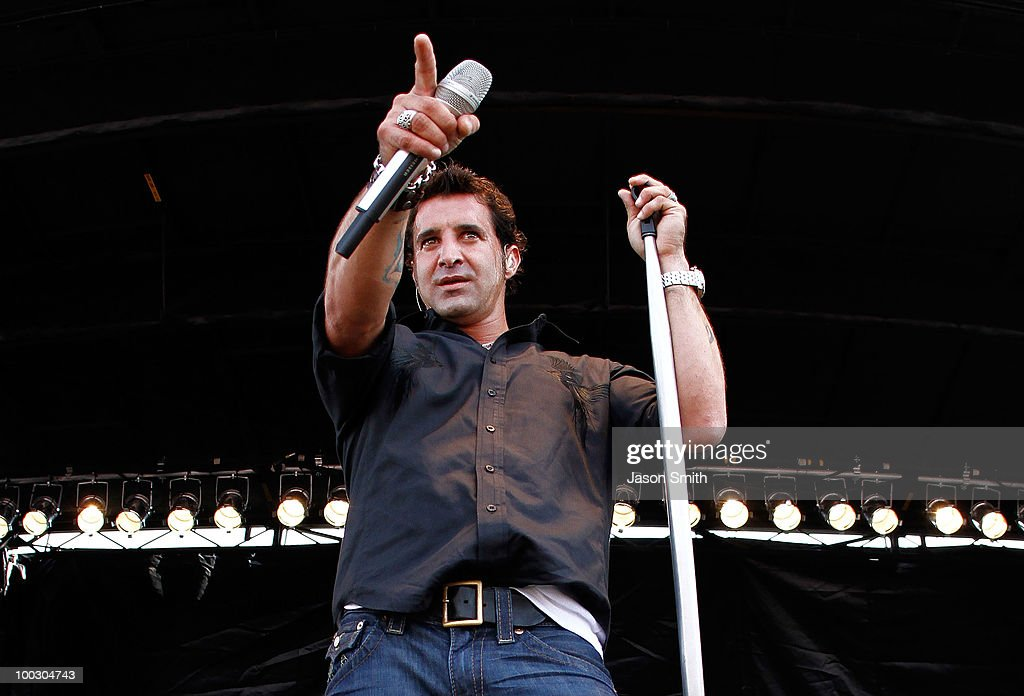 Lead singer of Creed <a gi-track='captionPersonalityLinkClicked' href=/galleries/search?phrase=Scott+Stapp&family=editorial&specificpeople=218051 ng-click='$event.stopPropagation()'>Scott Stapp</a> performs on stage prior to the NASCAR Sprint Cup Series All-Star Race at Charlotte Motor Speedway on May 22, 2010 in Concord, North Carolina.