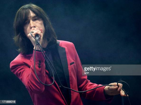 Lead singer of Scottish band Primal Scream Bobby Gillespie perfoms on the Pyramid Stage on the fourth day of the Glastonbury Festival of Contemporary...