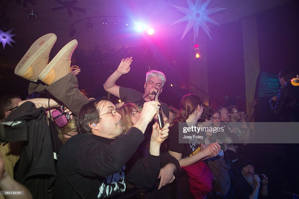 Lead singer Paul Mahern of Zero Boys goes crowd surfing as his band performs onstage in concert at The Vogue on March 4, 2013 in Indianapolis, Indiana.
