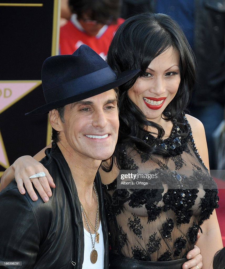 Lead singer Perry Farrell and wife Etty Lau Farrell of Jane's Addiction Honored On The Hollywood Walk Of Fame on October 30, 2013 in Hollywood, California.