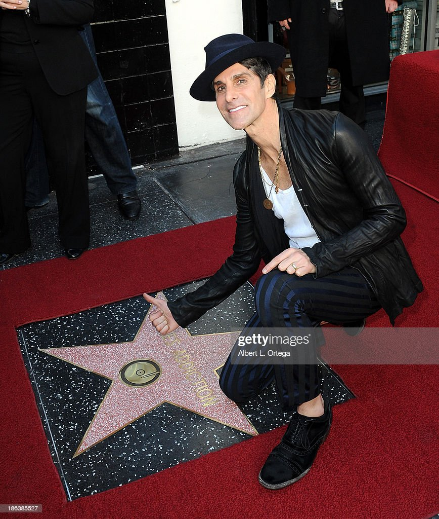 Lead singer <a gi-track='captionPersonalityLinkClicked' href=/galleries/search?phrase=Perry+Farrell&family=editorial&specificpeople=213012 ng-click='$event.stopPropagation()'>Perry Farrell</a> of Jane's Addiction Honored On The Hollywood Walk Of Fame on October 30, 2013 in Hollywood, California.