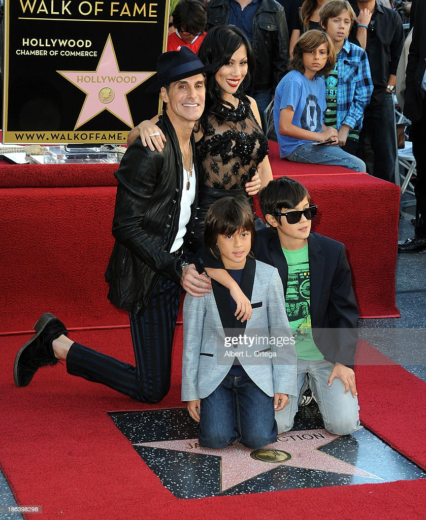 Lead singer Perry Farrell, wife Etty Lau Farrell ands sons Izzadore Bravo Farrell, Hezron Wolfgang Farrell attend as Jane's Addiction is Honored On The Hollywood Walk Of Fame on October 30, 2013 in Hollywood, California.