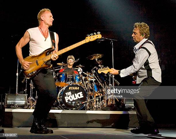 Lead singer Sting lead guitarist Andy Summers and drummer Stewart Copeland of the band The Police perform onstage to open their world tour at General...