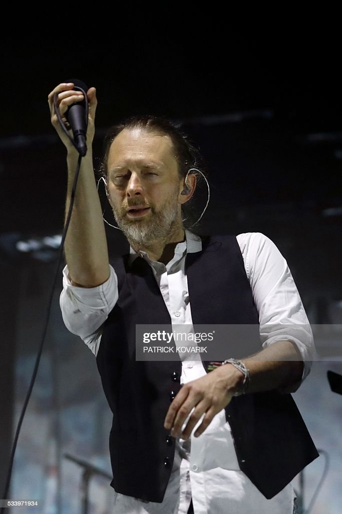 Lead singer Thom Yorke of the British band Radiohead performs on stage during a concert at the Zenith concert hall on May 24, 2016 in Paris. / AFP / PATRICK