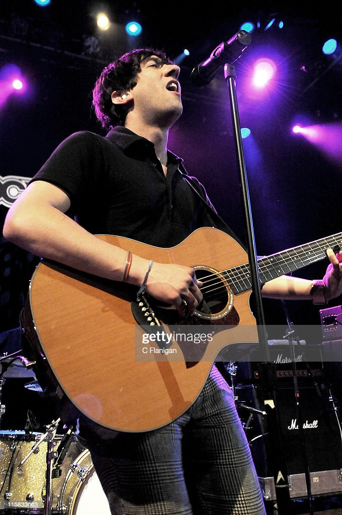 Lead singer Tom Higgenson of Plain White T's performs during the MTV Games Hosts Rock Band 2 Party to Benefit LIFEbeat at the House of Blues on...