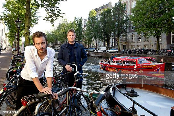 Lead singer Tom Smith and bassist Russell Leetch of British rock band Editors pose for a portrait session by the canal in Amsterdam Netherlands 2nd...