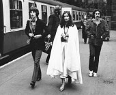 Lead singer with The Rolling Stones Mick Jagger accompanied by Bianca PerezMora Macias as he walks through Lime Street Station for a concert at the...