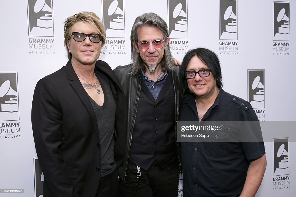 Lead singer/guitarist John Rzeznik Vice President of the GRAMMY Foundation Scott Goldman and bassist Robby Tabac of the Goo Goo Dolls attend The Drop...
