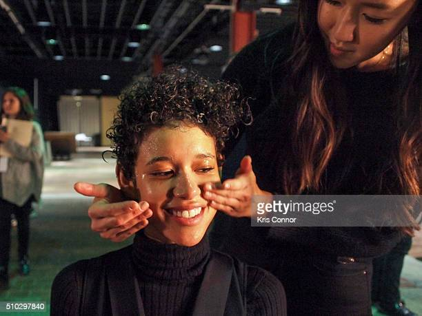 Lead Skincare Stylist Nina Park with a model backstage during Dr Jart for Opening Ceremony Fall/Winter 2016 show during New York Fashion Week at Pier...