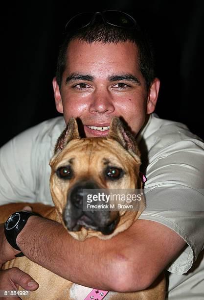 michael vick dog. lead trainer john garcia poses with rehabilitated michael vick dog georgia of \u0027dogtown saving the