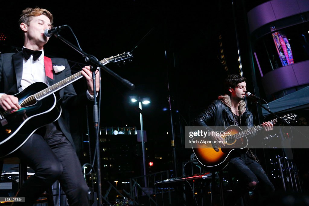 Lead vocalist Ryan Follese (L) and bassist Ian Keaggy of Hot Chelle Rae perform onstage at The 3rd Annual Salvation Army Rock The Red Kettle Concert at Nokia Theatre L.A. Live on December 15, 2012 in Los Angeles, California.