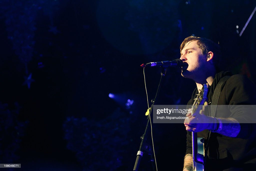 Lead vocalist/guitarist <a gi-track='captionPersonalityLinkClicked' href=/galleries/search?phrase=Brian+Fallon&family=editorial&specificpeople=3408585 ng-click='$event.stopPropagation()'>Brian Fallon</a> of The Gaslight Anthem performs at the 23rd Annual KROQ Almost Acoustic Christmas at Gibson Amphitheatre on December 8, 2012 in Universal City, California.