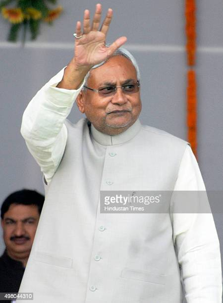 JDU leader and Bihar Chief Minister Nitish Kumar greets the gathering during his oath taking ceremony on November 20 2015 in Patna India JDU leader...