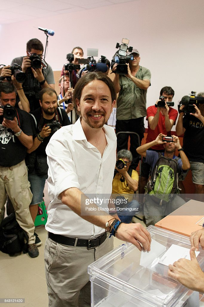 Leader and candidate of left wing alliance party Unidos Podemos 'United We Can' Pablo Iglesias poses for photographers as he casts his vote at a polling station during the Spanish General Elections on June 26, 2016 in Madrid, Spain. Spanish voters head back to the polls after the last election in December failed to produce a government. Latest opinion polls suggest the Unidos Podemos left-wing alliance could make enough gains to come in second behind the ruling center right Popular Party.