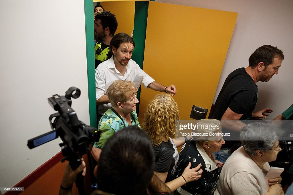 Leader and candidate of left wing alliance party Unidos Podemos 'United We Can' Pablo Iglesias (L) queues to cast his vote at a polling station during the Spanish General Elections on June 26, 2016 in Madrid, Spain. Spanish voters head back to the polls after the last election in December failed to produce a government. Latest opinion polls suggest the Unidos Podemos left-wing alliance could make enough gains to come in second behind the ruling center right Popular Party.