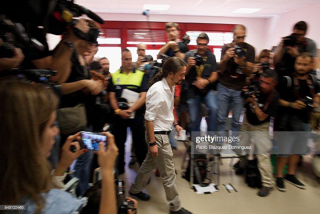 Leader and candidate of left wing alliance party Unidos Podemos 'United We Can' Pablo Iglesias walks to cast his vote at a polling station during the Spanish General Elections on June 26, 2016 in Madrid, Spain. Spanish voters head back to the polls after the last election in December failed to produce a government. Latest opinion polls suggest the Unidos Podemos left-wing alliance could make enough gains to come in second behind the ruling center right Popular Party.
