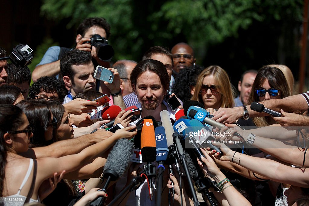 Leader and candidate of left wing alliance party Unidos Podemos 'United We Can' Pablo Iglesias (C) speaks to the press after casting his vote during the Spanish General Elections on June 26, 2016 in Madrid, Spain. Spanish voters head back to the polls after the last election in December failed to produce a government. Latest opinion polls suggest the Unidos Podemos left-wing alliance could make enough gains to come in second behind the ruling center right Popular Party.