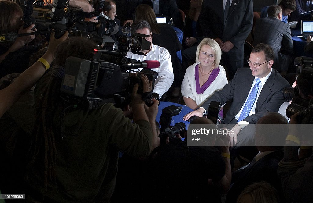 Leader and Chairman of the Czech Civic Democratic Party (ODS), Petr Necas (R) and his wife Radka watch the exit polls for the Czech general elections at the Czech public TV Canal CT24 on May 29, 2010 in Malostranska Beseda in Prague. Left-wing Social Democrats and right-wing Civic Democrats came neck-and-neck in the Czech general election Saturday, exit polls showed, in a surprise outcome that paves the way for a coalition government. PHOTO