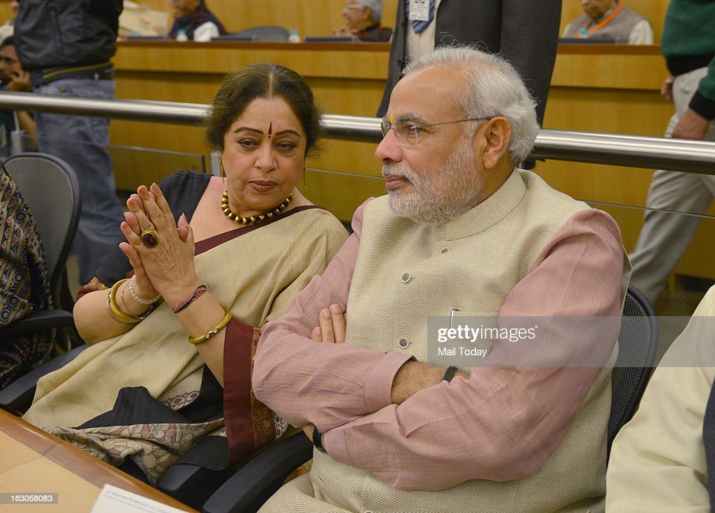 BJP leader and Gujarat Chief Minister Narendra Modi with Kirron Kher at BJP National Executive in New Delhi on Friday.