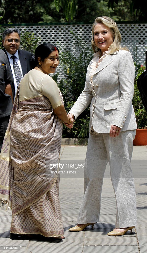 BJP leader and Leader of Opposition in Lok Shabha <a gi-track='captionPersonalityLinkClicked' href=/galleries/search?phrase=Sushma+Swaraj&family=editorial&specificpeople=2147656 ng-click='$event.stopPropagation()'>Sushma Swaraj</a> and U.S. Secretary of State <a gi-track='captionPersonalityLinkClicked' href=/galleries/search?phrase=Hillary+Clinton&family=editorial&specificpeople=76480 ng-click='$event.stopPropagation()'>Hillary Clinton</a> greet each other before a meeting at Sushma's Residence on May 8, 2012 in New Delhi, India. On last leg of of her 3 day visit to India, U.S. Secretary of State pushed for reducing oil imports with Iran.