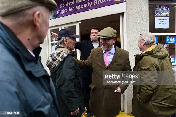 UKIP leader and parliamentary candidate Paul Nutgall center campaigns in Stoke on Trent United Kingdom on February 22 2016 A crucial election is...
