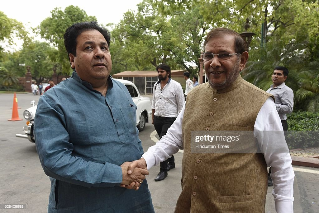 JDU Leader and Rajya Sabha MP Sharad Yadav with Congress MP Rajeev Shukla during the Parliament session on May 4, 2016 in New Delhi, India. Congress walks out of the House demanding time-bound Supreme Court-monitored CBI probe on the AgustaWestland helicopter deal.