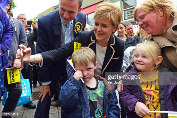 SNP leader and Scottish First Minister Nicola Sturgeon takes a selfie with a young supporter on a campaign walkabout after flying into Fife on her...