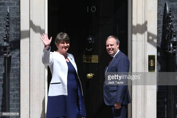 DUP leader Arlene Foster and MP Nigel Dodds arrive at 10 Downing Street on June 13 2017 in London England Discussions between the DUP and the...