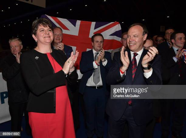 DUP leader Arlene Foster celebrates with DUP deputy leader Nigel Dodds at the Belfast count centre on June 9 2017 in Belfast Northern Ireland After a...