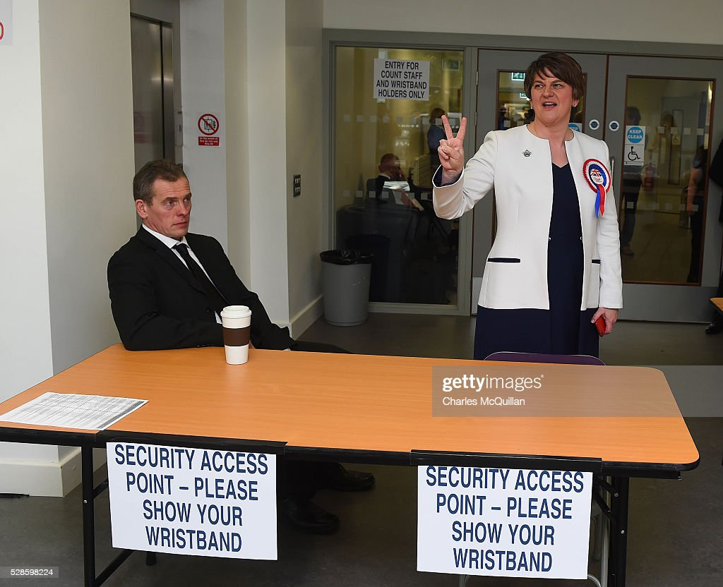 DUP leader Arlene Foster (R) gives a victory sign after being elected at the Northern Ireland Assembly count at Omagh Leisure on May 6, 2016 in Omagh, Northern Ireland. Two hundred and seventy six candidates are contesting 108 seats across the province. The Democratic Unionist Party are predicted to return as the largest political party in the province with Arlene Foster also returned as First Minister of the power sharing government with Sinn Fein the second largest party.