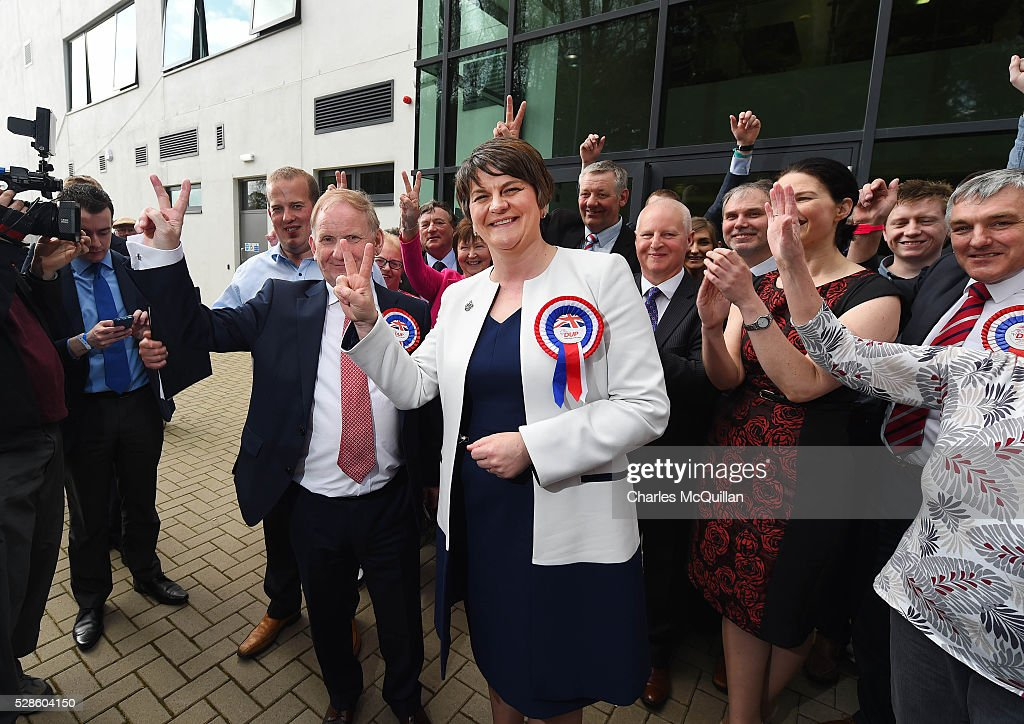DUP leader Arlene Foster (C) gives a victory sign after being elected at the Northern Ireland Assembly count at Omagh Leisure on May 6, 2016 in Omagh, Northern Ireland. Two hundred and seventy six candidates are contesting 108 seats across the province. The Democratic Unionist Party are predicted to return as the largest political party in the province with Arlene Foster also returned as First Minister of the power sharing government with Sinn Fein the second largest party.