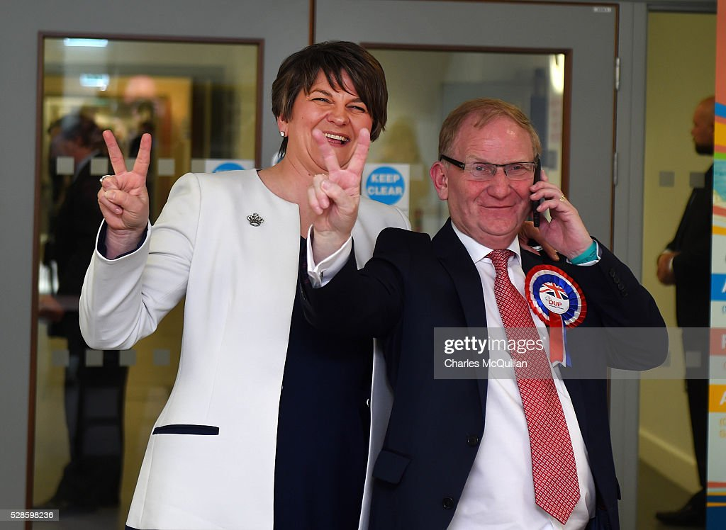DUP leader Arlene Foster (L) gives a victory sign alongside DUP chairman and fellow candidate Lord Morrow (R) after being elected at the Northern Ireland Assembly count at Omagh Leisure on May 6, 2016 in Omagh, Northern Ireland. Two hundred and seventy six candidates are contesting 108 seats across the province. The Democratic Unionist Party are predicted to return as the largest political party in the province with Arlene Foster also returned as First Minister of the power sharing government with Sinn Fein the second largest party.
