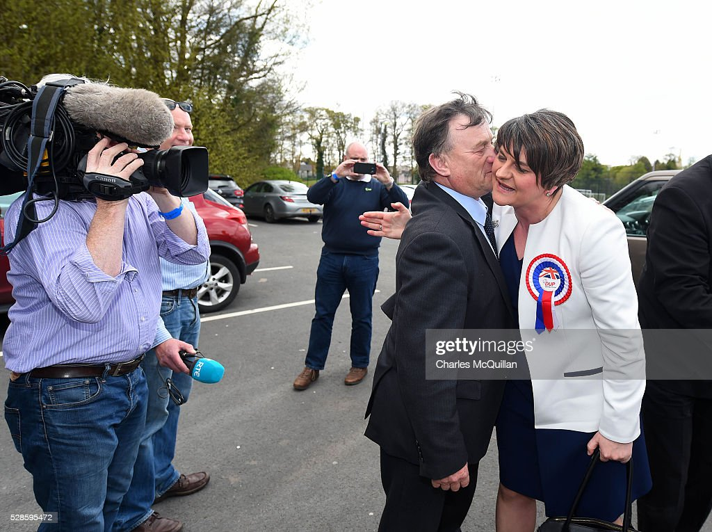 DUP leader Arlene Foster (R) is welcomed by party members as she arrives at the Northern Ireland Assembly elections count at Omagh Leisure on May 6, 2016 in Omagh, Northern Ireland. 276 candidates are contesting 108 seats across the province. The Democratic Unionist Party are predicted to return as the largest political party in the province with Arlene Foster also returned as First Minister of the power sharing government with Sinn Fein the second largest party.