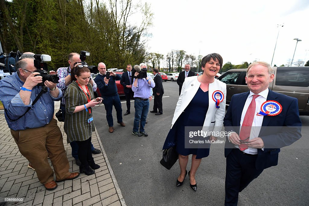 DUP leader Arlene Foster (2nd R) is welcomed by party members as she arrives at the Northern Ireland Assembly elections count at Omagh Leisure on May 6, 2016 in Omagh, Northern Ireland. 276 candidates are contesting 108 seats across the province. The Democratic Unionist Party are predicted to return as the largest political party in the province with Arlene Foster also returned as First Minister of the power sharing government with Sinn Fein the second largest party.